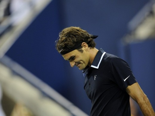 Swiss tennis player Roger Federer reacts